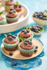 Homemade muffin with blueberries and chocolate cream