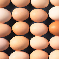 Background of brown eggs stacked in a row