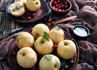 Pickled apples served on an earthenware plates