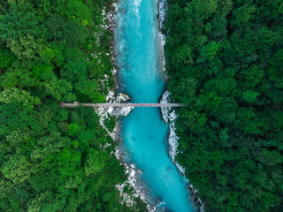 Blue water of Soca river, top down drone view