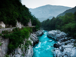 Dramatic Soca river flows in rocky mountains