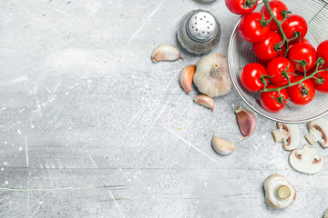 Organic food. Fresh tomatoes with mushrooms and spices.