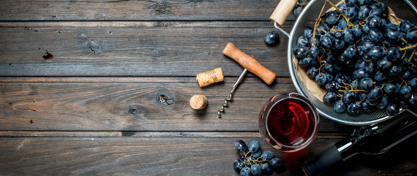 Wine background. Red wine in glasses with grapes.