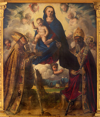 Wall Mural - MODENA, ITALY - APRIL 14, 2018: The painting of Madonna with the st. Matin and St. Geminianus in church Abazzia di San Pietro by Filippo da Verona (1520).