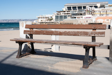 Marseille, Plage des Catalans - Marseille old bench on the beach of the Catalans