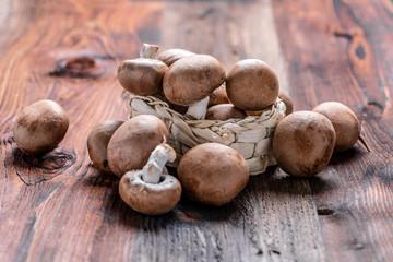 Closeup of fresh mushrooms (agaricus) on a wooden board
