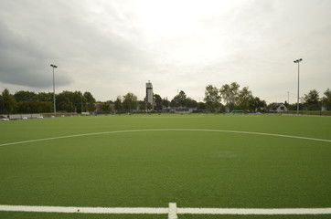 newly laid artificial turf, football pitch on the football stadium