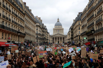 """Students take part in a """"youth strike to act on climate change"""" demonstration in Paris"""