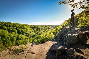Beautiful girl hiker enjoys view over Soderasen Skaralid valley Sweden