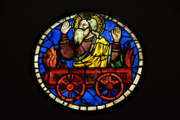 Foto auf Leinwand Buntglasfenster Saint Elias on the fiery chariot, stained glass by Taddeo Gaddi in the Basilica di Santa Croce in Florence, Italy