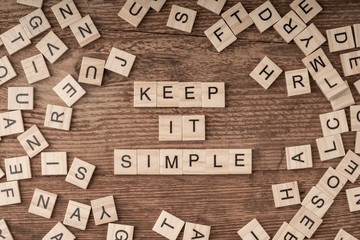 Keep it simple written with wooden letters