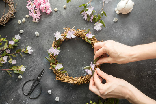 Spring wreath with flowers. Creative flat lay. View from above.