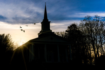 Sunset At Church As Birds Fly