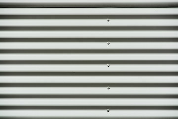 Corrugated white painted metal sheet texture background