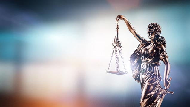 Themis, symbol of law on modern background.
