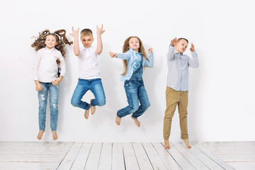 Kids boys and girls merry happy beautiful on white wall background
