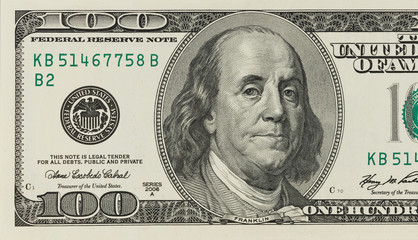 Macro shot of a 100 dollar concept economic.