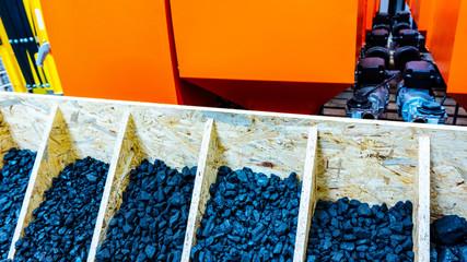 Coal stock . Coal pieces texture . Heaps of coal . House boiler room