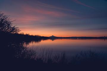 Subtle sunrise sky over Columbia River and Mt Hood