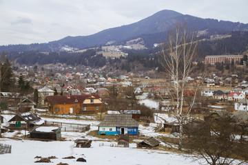 Spring vs winter landscape in the Carpathian mountains