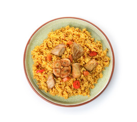 Plate with rice pilaf and meat on white background, top view