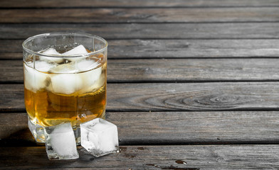 Whiskey in a glass with ice cubes.