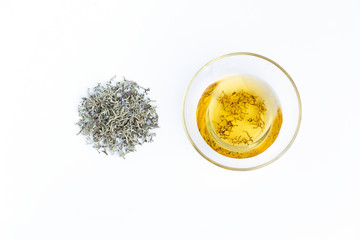 Medicinal herb in bottles on white background top view copyspace
