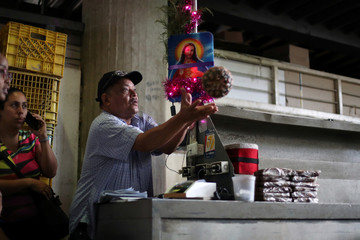 A man catches a pineapple inside a commercial center in Caracas