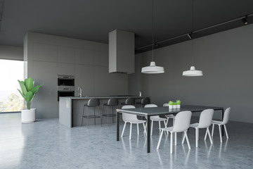 Gray kitchen corner with countertops and table
