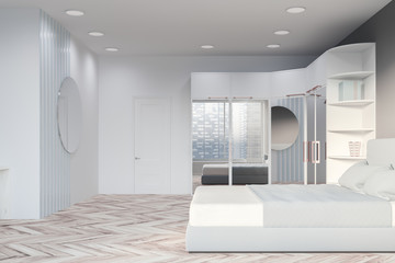 Side view of gray bedroom with wardrobe