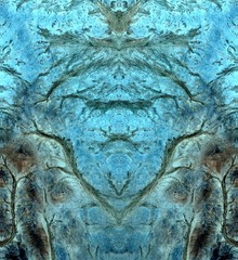 abstract symmetrical vertical photograph of the deserts of Africa from the air, aerial view, abstract expressionism, mirror effect, symmetry, kaleidoscopic