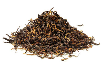 Heap of black tea on white background. Close up. High resolution.