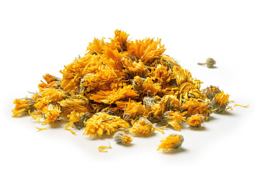 Heap of medicinal flowers of a calendula on white background. Herbal tea. Close up. High resolution