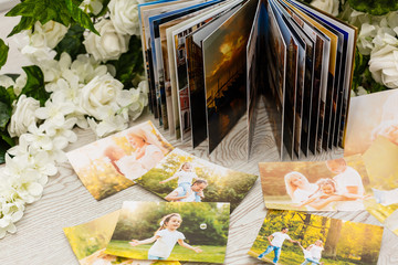 Photo book with a cover . White color with openwork stamping. Soft focus.
