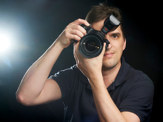 Male photographer taking a picture straight ahead of you