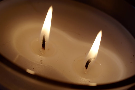 White candle burning two flames