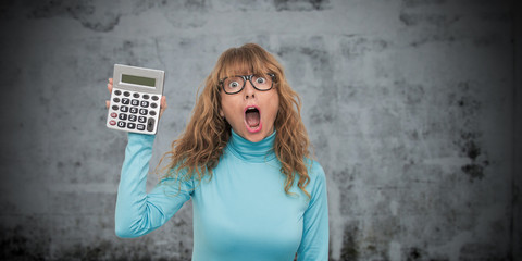 isolated woman with calculator astonished with surprise