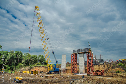 Panel formwork and crane on the construction of the vertical walls
