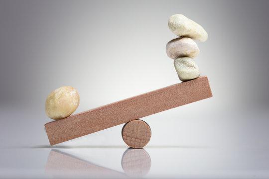 Pebble Stones Balancing On Seesaw