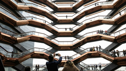 People tour the inside 'The Vessel,' a large public art sculpture made up of 155 flights of stairs, during the grand opening of the The Hudson Yards development in New York