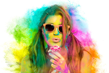 Beautiful woman covered in rainbow colored powder. Holi colors festival