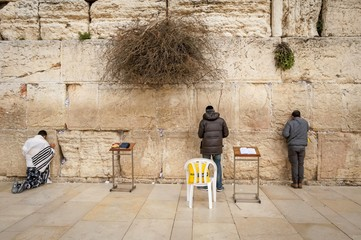 JERUSALEM, ISRAEL. February 15, 2019. Jewish people praying at the Western Wall aka Wailing wall in the old city of Jerusalem. Jewish prayer concept.