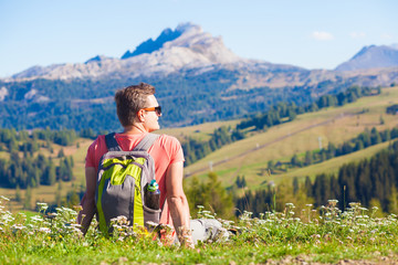 portrait of young man hiking in Alta Badia, Dolomites