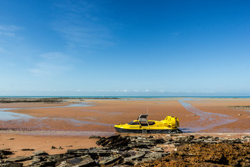 yellow hovercraft at a beautiful beach in broom, western australia