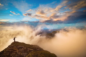 Taking a selfie above the clouds mountain sunset landscape in Romania