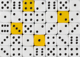 Background of random ordered white dices with four yellow cubes