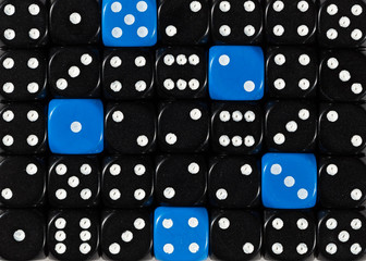 Background of random ordered black dices with five blue cubes
