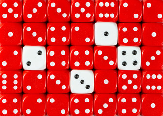 Background of random ordered red dices with four white cubes