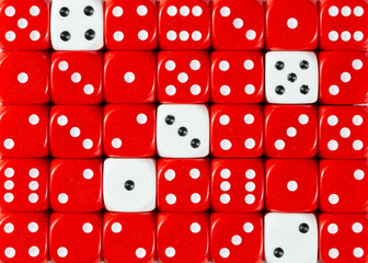 Background of random ordered red dices with five white cubes