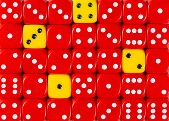 Background of random ordered red dices with four yellow cubes